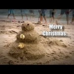 Snowman Smashed on Sunny Sand