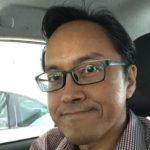 Adrian Lee in Car